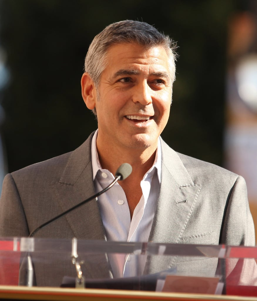George Clooney in a gray suit.