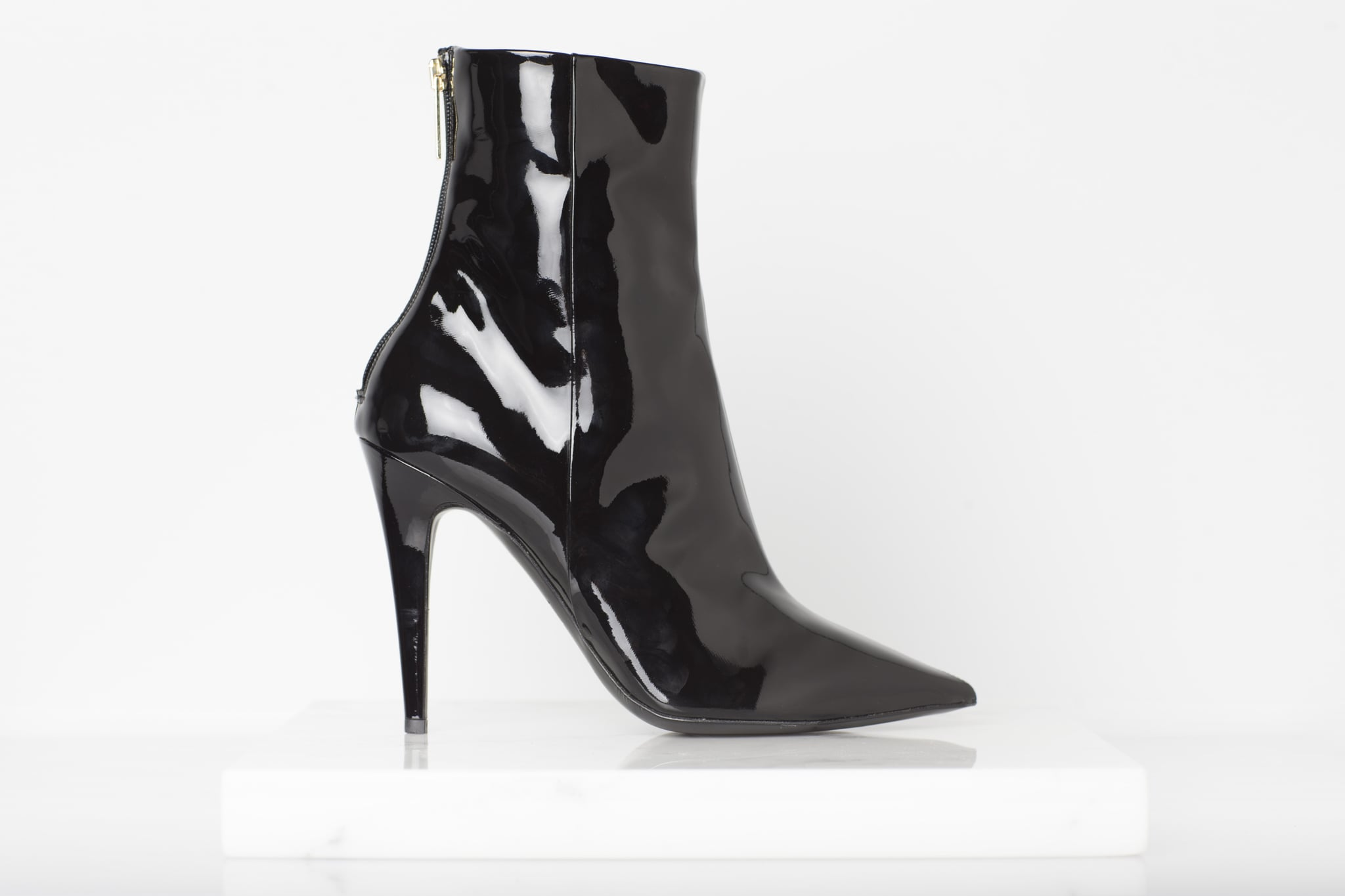 Excess Patent Ankle Boot in Black ($895) Photo courtesy of Tamara Mellon