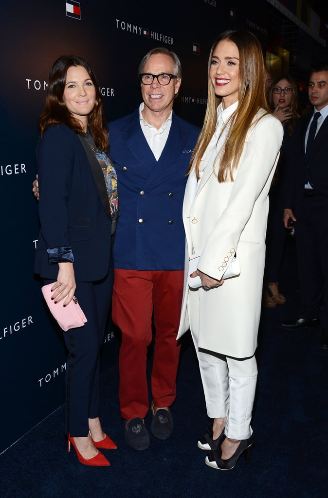 Drew Barrymore, Jessica Alba, and Tommy Hilfiger posed together on the red carpet.
