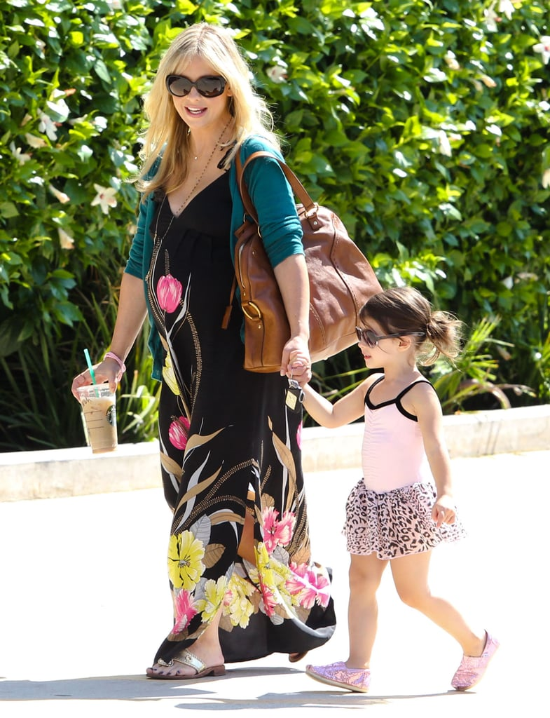 Sarah Michelle Gellar showed off her growing baby bump in a long dress.