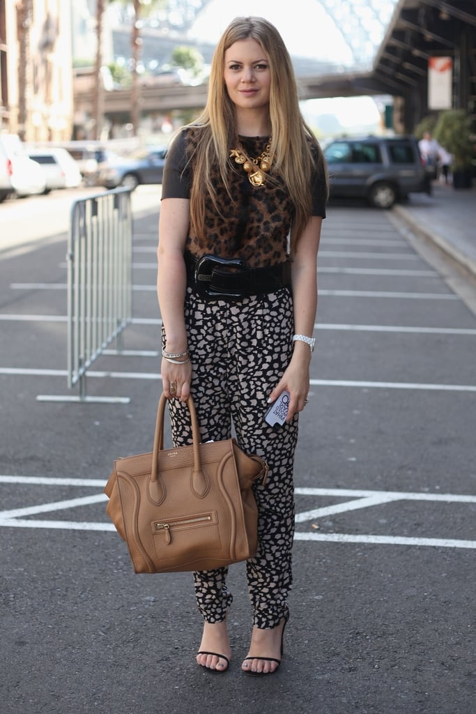 Talk about a daring printed mix — her leopard top and giraffe pants made for quite an eye-catching dynamic. And of course, we love her camel-colored Céline luggage tote, too.