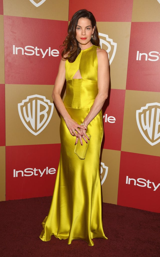 Michelle Monaghan put a bright spin on her after party ensemble, opting for a vibrantly silky chartreuse  number and a red lip.