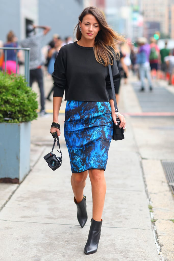 Keep your outfit just as interesting, despite the rain, with a printed skirt to jazz things up. Your staple black booties are always a good option in the rain.