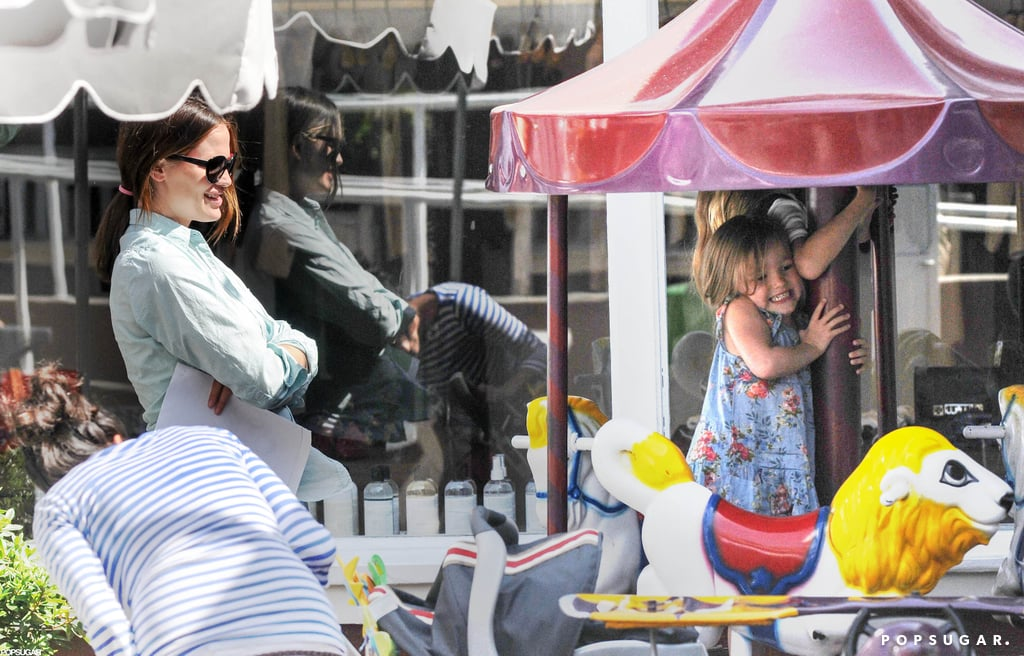 Jennifer Garner watched as Seraphina Affleck and Violet Affleck had a blast riding a merry-go-round in LA in May.