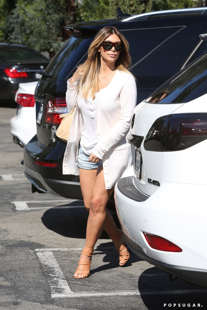 Kim Kardashian Covers Up in a Cardigan After Baring Her Body Online