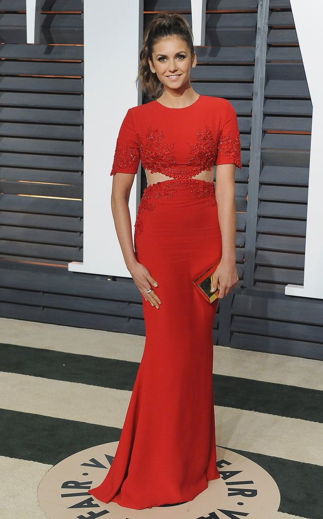 The star looked lovely in a cutout red Reem Acra gown at Elton John's 2015 Oscars viewing party.