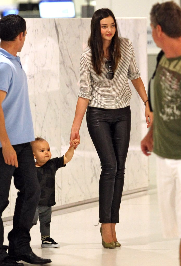 Flynn Bloom showed off his walking skills with the help of his mom upon their arrival at LAX in February 2012.