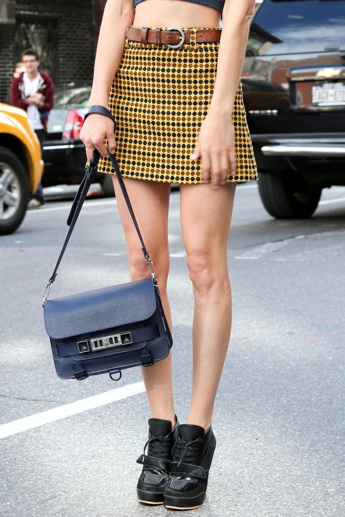 A Proenza Schouler satchel in the perfect Fall navy played a classic complement to another Fall staple: plaid.