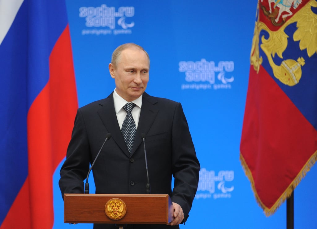 "For his part, Russian President Vladimir Putin attended a ceremony for winners of the Sochi Paralympic Games on Monday. But that's not all he was up to. He also signed a presidential decree recognizing Crimea ""as a sovereign and independent state"" following the referendum, paving the way for it to join Russia."