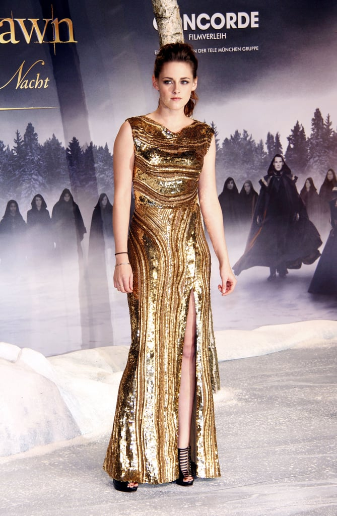 We couldn't get enough of the embellished gold Elie Saab gown that Kristen wore at the Germany premiere of Breaking Dawn Part 2 in November. She showed off a pair of Christian Louboutin cage heels — and lots of leg — thanks to the gown's thigh-high slit.