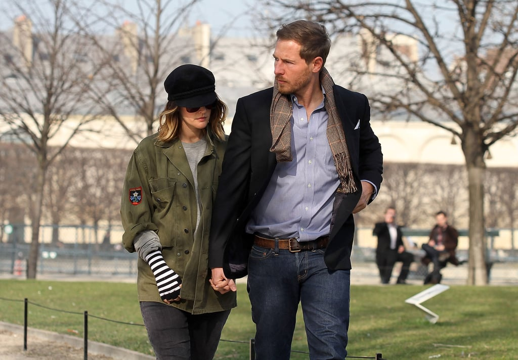 Drew Barrymore takes a stroll in the Tuileries with fiancé Will Kopelman.