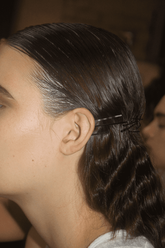 """Bobby pins never really go away, but they were used as a major accent at Thakoon. """"If they exist for a million years, there is a reason,"""" Gilbert said. """"The barrettes represent the cage. And it could be a wedding look if you add flowers or a veil."""""""