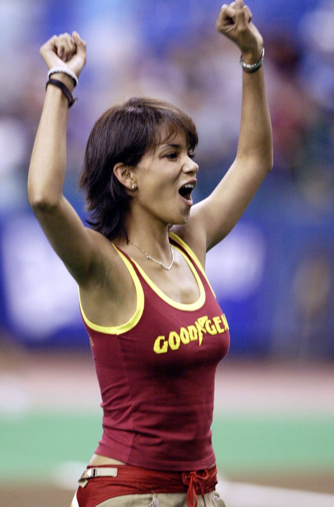 Halle Berry gave a cheer after throwing out the first pitch at the LA Dodgers game in May 2003.