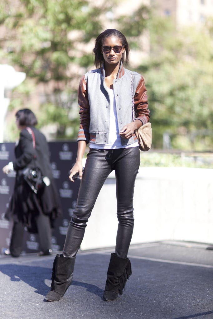 This styler played the leather look with added interest via a pair of fringed boots and a varsity jacket. Source: Adam Katz Sinding