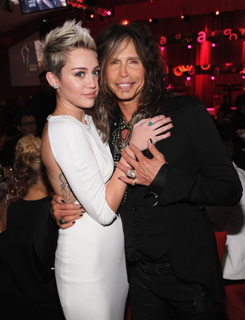 Miley Cyrus hugged Steven Tyler at Elton John's Oscar party.