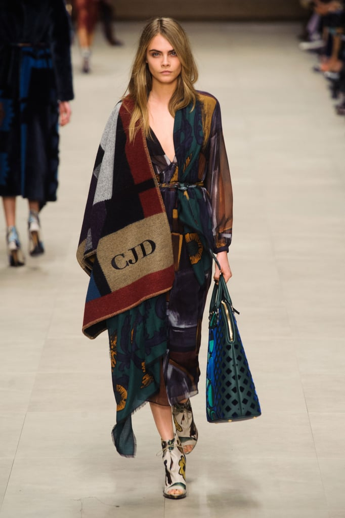 To be fair, Cara Delevingne had her monogrammed poncho first when she walked the Burberry Fall '14 runway.