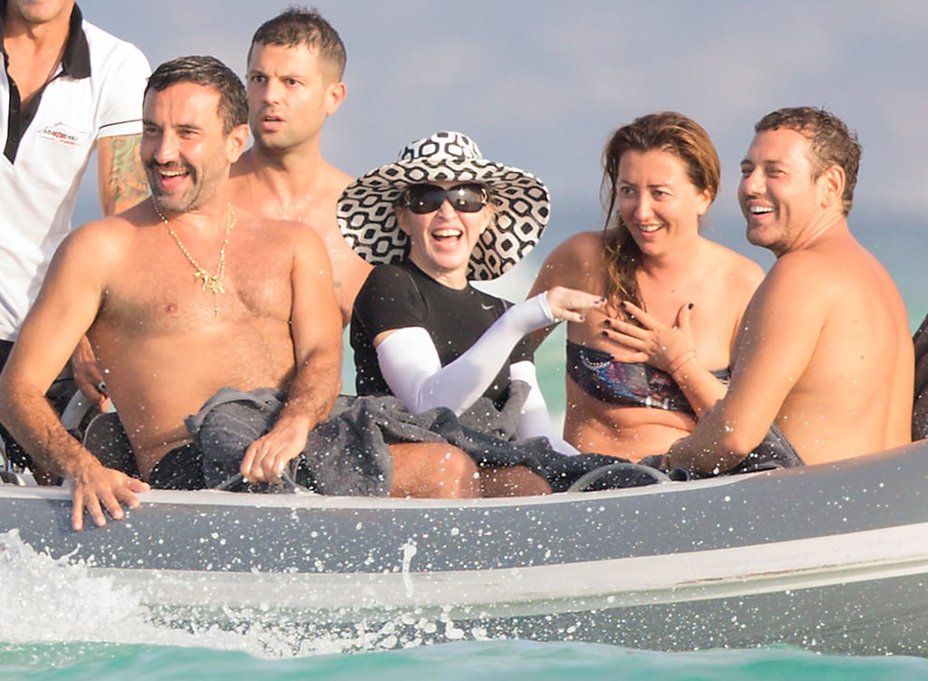 Madonna was surrounded by tan friends on the open water in Formentera, Spain, on Tuesday.