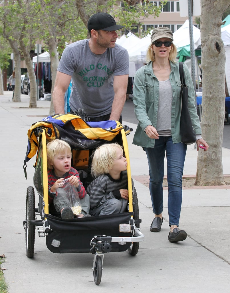 Liev Schreiber and Naomi Watts took their boys, Sasha and Kai, to an LA park and the farmers market on Sunday.
