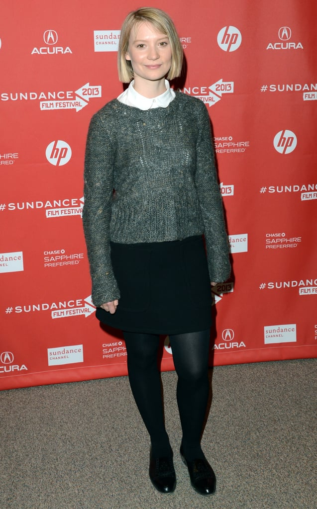 Mia Wasikowska sported this Joe's gray sweater ($139, originally $198) over a white Peter Pan-collar blouse, then completed her preppy outfit with a black miniskirt, black tights, and boots.