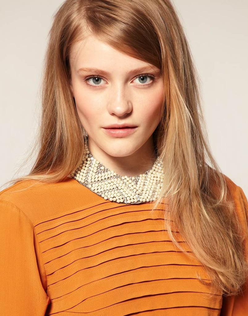We love how this beaded collar looks when paired with a mustard-colored blouse, as styled here. It would also look great when popped over an LBD. ASOS Pearl and Diamanté Collar ($25)