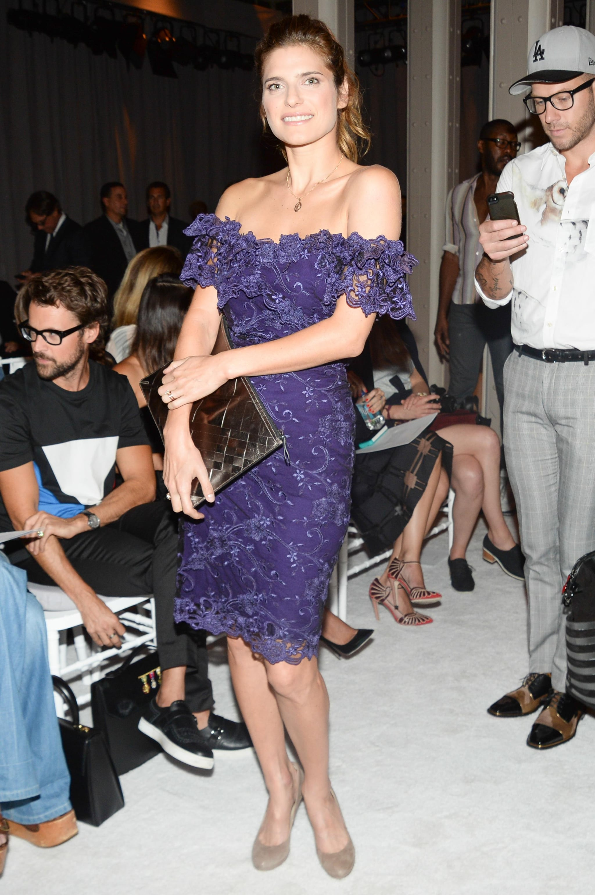 Lake Bell put her shoulders on display in a purple, textured, off-the-shoulder Marchesa dress at the Spring 2014 show.