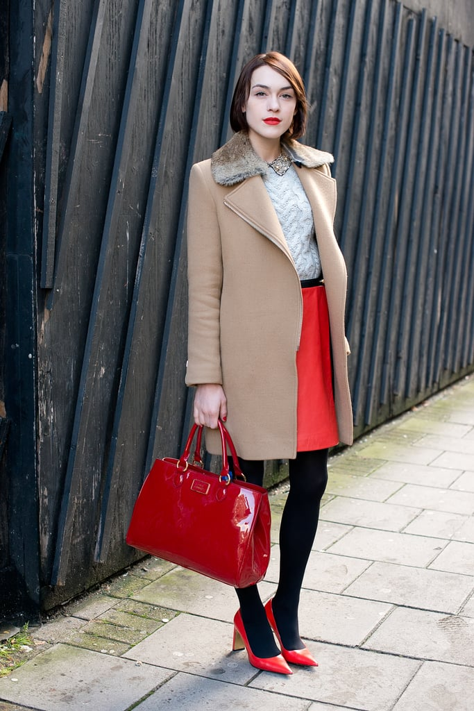 Ella Catliff knows that a little red goes a long way and happens to look gorgeous with a camel-hued coat.
