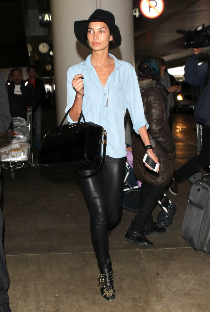 In leather skinnies and studded ankle boots, Lily Aldridge looked every part the rock-star wife as she touched down in Los Angeles. She let a little bit of her Nashville roots show through, though, pairing all that black with a chambray top.