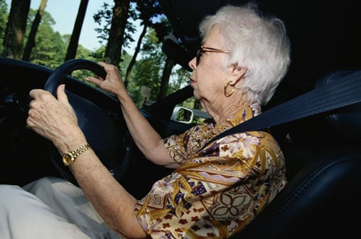 Grandma Drives with Child on Top of Car