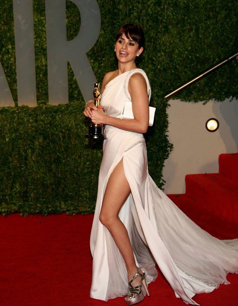 After winning the best supporting actress Oscar for her role in Vicky Cristina Barcelona in February 2009, Penélope partied in a Grecian white gown with a thigh-high slit at the Vanity Fair Oscars party in LA.