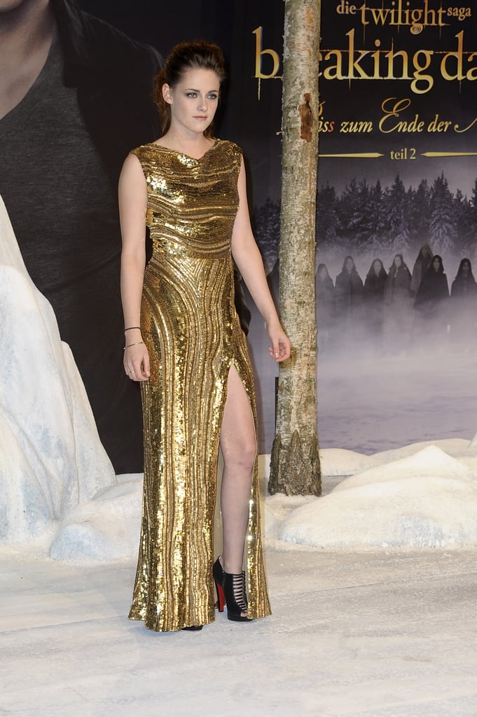 Kristen's slit revealed a pair of strappy open-toe Christian Louboutin booties.