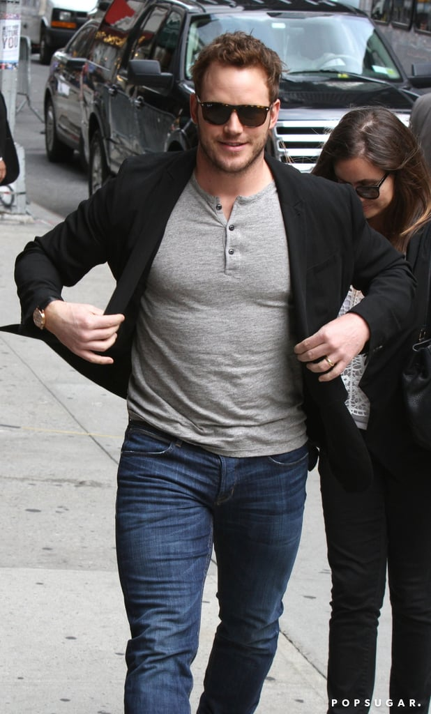 Chris Pratt's trying desperately to button his jacket with little to no success.