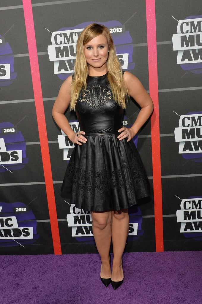 Kristen Bell wore a black leather dress and heels at the CMT Awards.