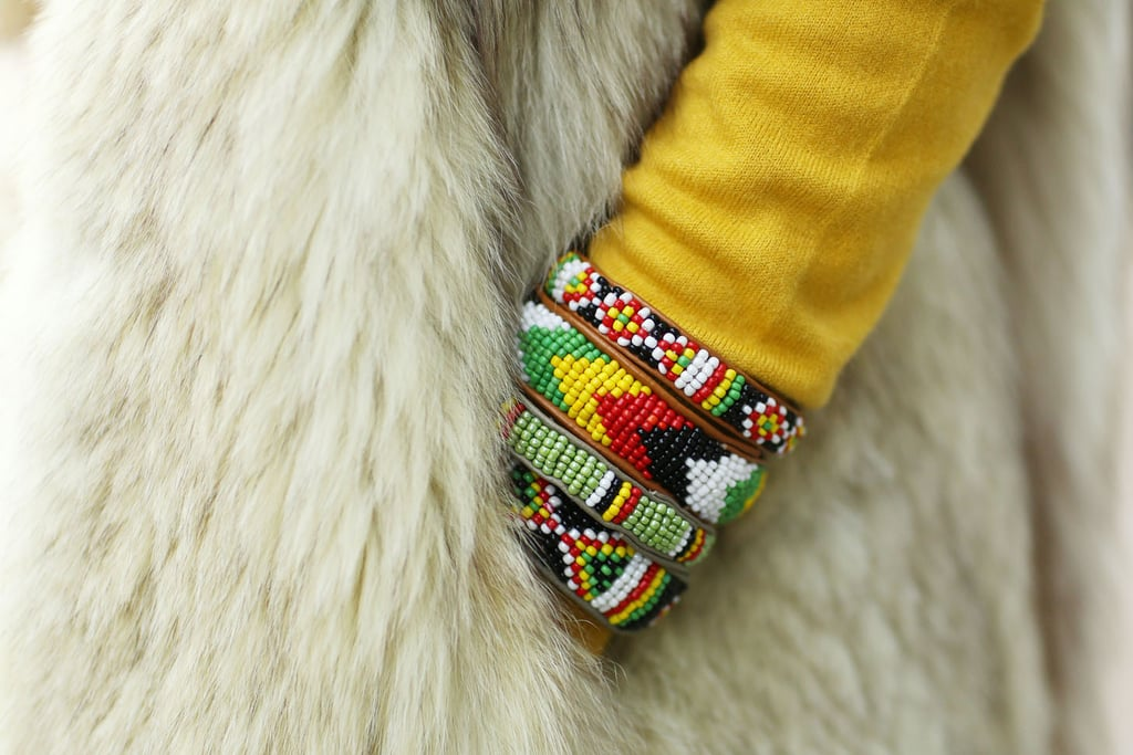 Eclectic bracelets brighten up a furry layer.  Source: Tim Regas