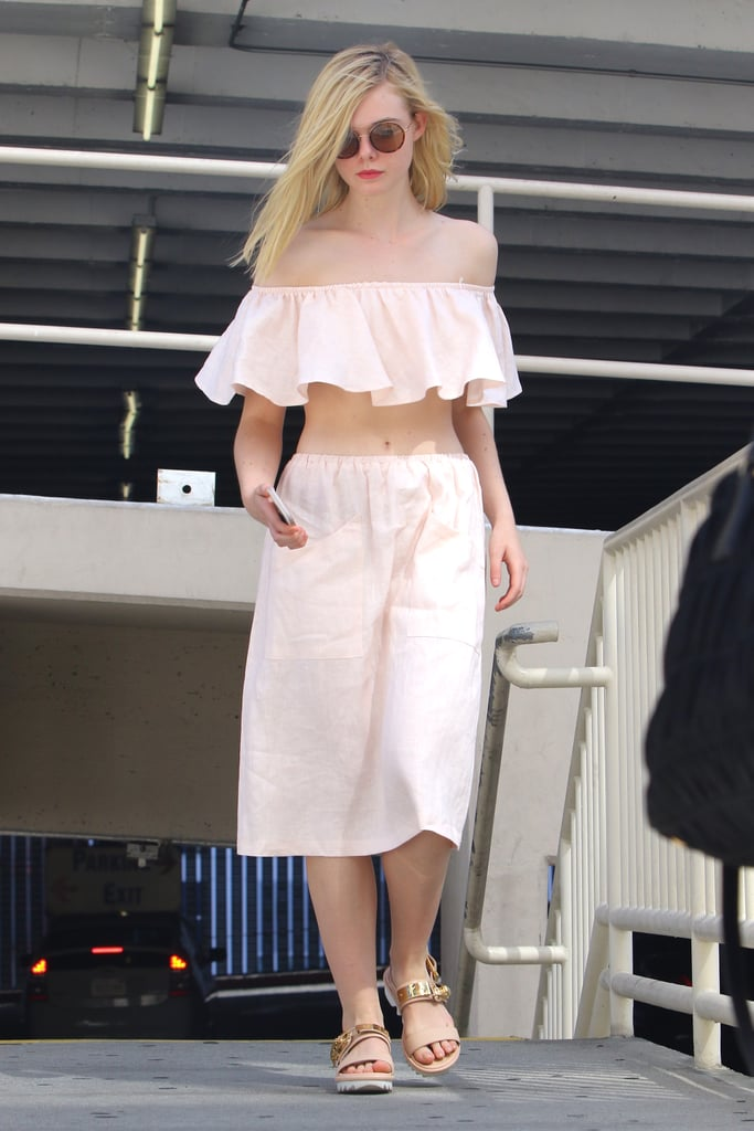 """You might be surprised to learn that Elle Fanning wore this coordinated set last October, but it's been on my mind ever since. ""That's my ideal Summer look,"" I thought. While I might swap the actress's chunky metallic sandals for my new favorite espadrille wedges, a flouncy crop top and movable midi will take me straight from the beach to a night-long BBQ. The best part is, I don't have to think so hard about styling. A solid two-piece looks totally polished, but in reality, it's throw-on-and-go simple."" — Sarah Wasilak, assistant editor, Fashion"