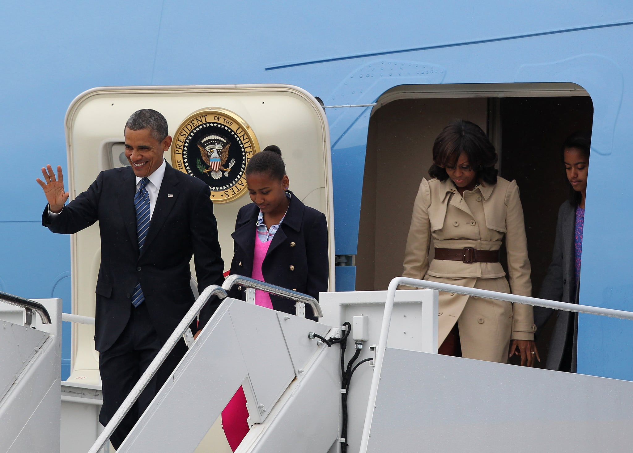 The first family landed in Belfast, and upon exiting Air Force One, Michelle Obama showed off a beautiful, buttery Burberry trench coat.