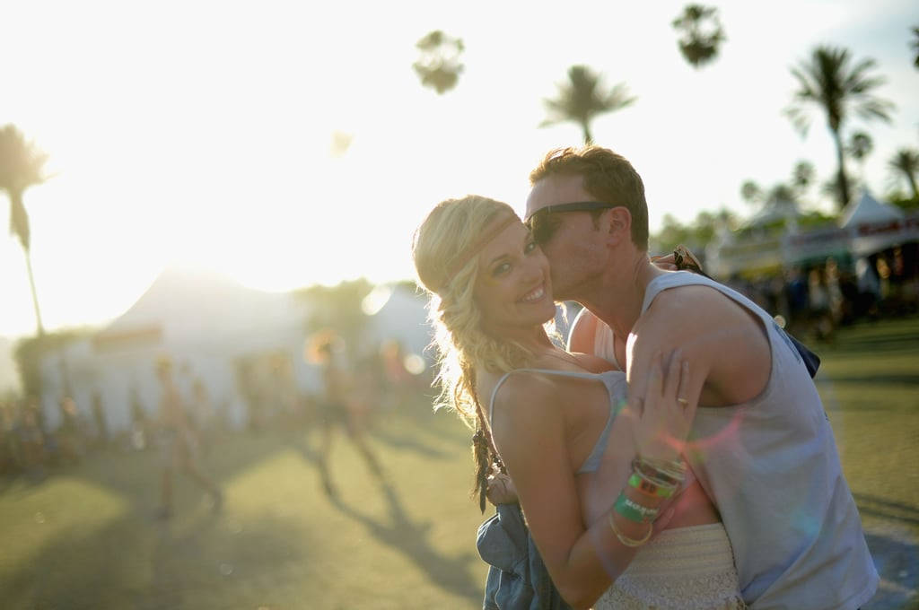 A guy kissed his lady at Coachella in Indio, CA.