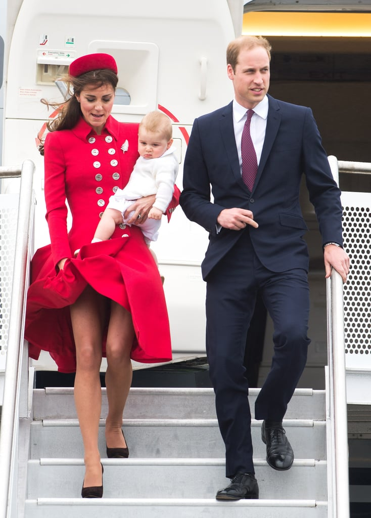Kate narrowly avoided a fashion disaster when the wind swept up her skirt as she and Princes William and George walked off their plane in Wellington on April 7.