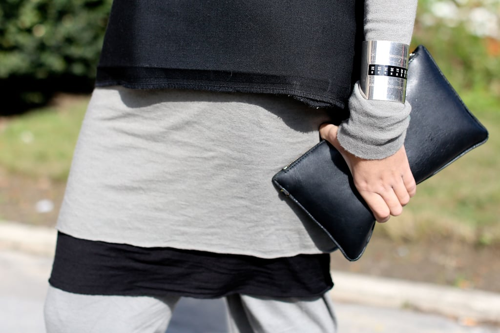 In keeping with the outfit's minimalism, this understated clutch and sleek metal cuff were just the right pieces to finish it off.