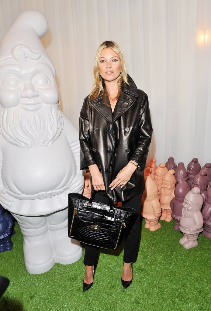 Kate Moss outfitted a slick leather trench with classic black trousers and pumps for her arrival at Mulberry.