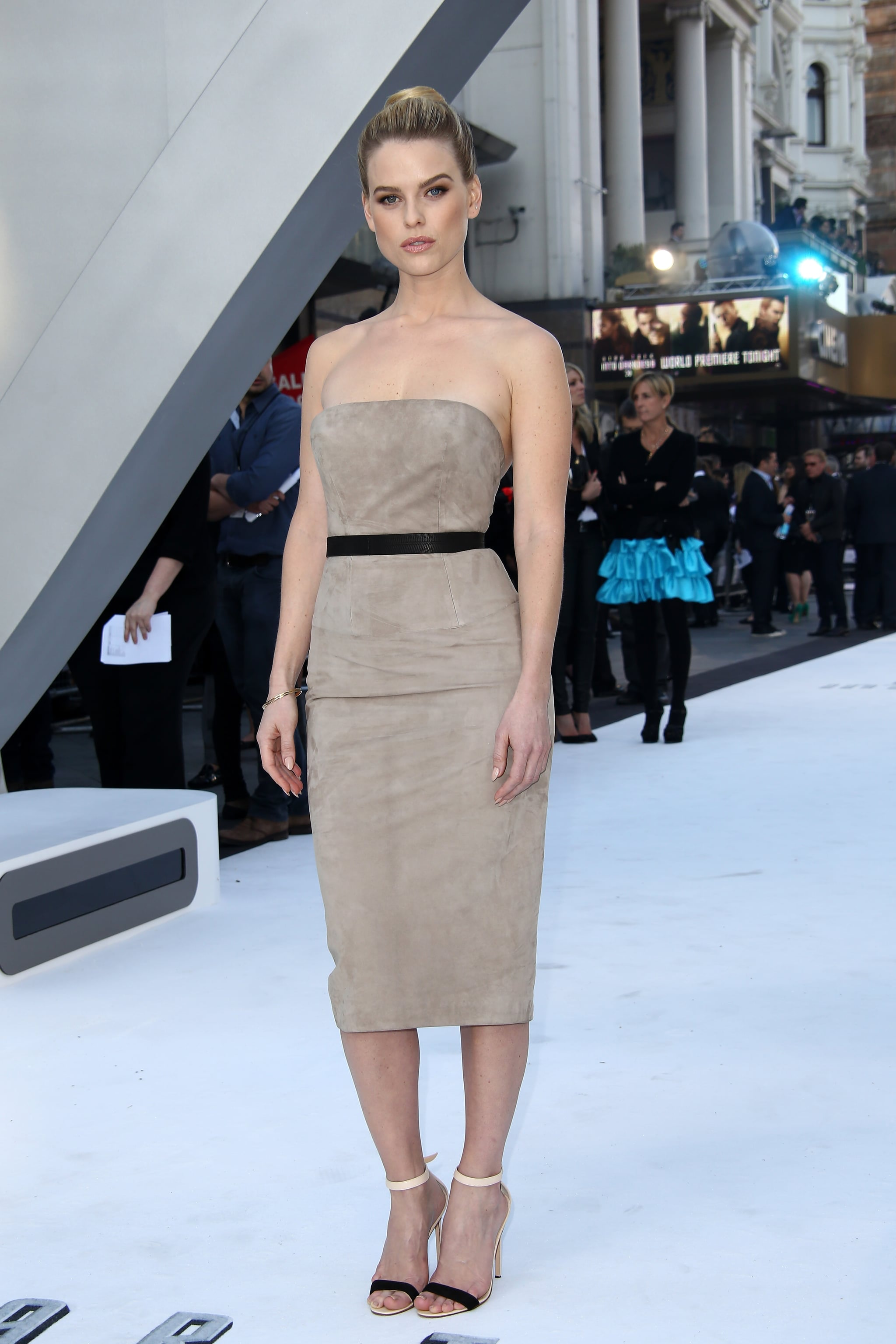 Alice Eve's taupe suede strapless midi dress was muted but certainly not boring at the London premiere. A black leather belt cinched her waist, while two-toned ankle-strap sandals were a beautifully elegant touch.