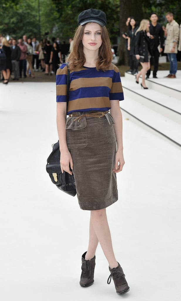 Tali Lennox arrived at Burberry in a peplum-trimmed pencil skirt and a striped tee.