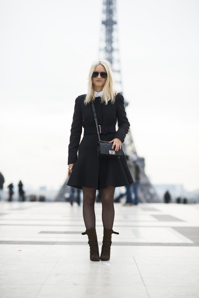 The fashion girl's version of all the right stuff — a classic coat, slick shades, statement boots, and a Chanel bag.  Source: Le 21ème   Adam Katz Sinding