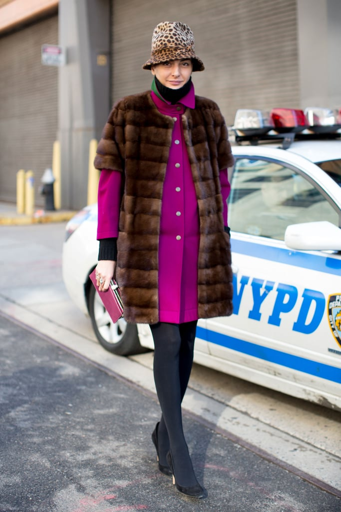 Giovanna Battaglia layered up her bright, ladylike outerwear with a luxe fur.