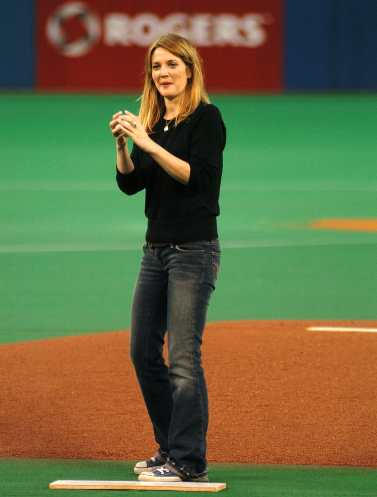 Drew Barrymore got ready to throw the first pitch at a Toronto Blue Jays game in October 2004.
