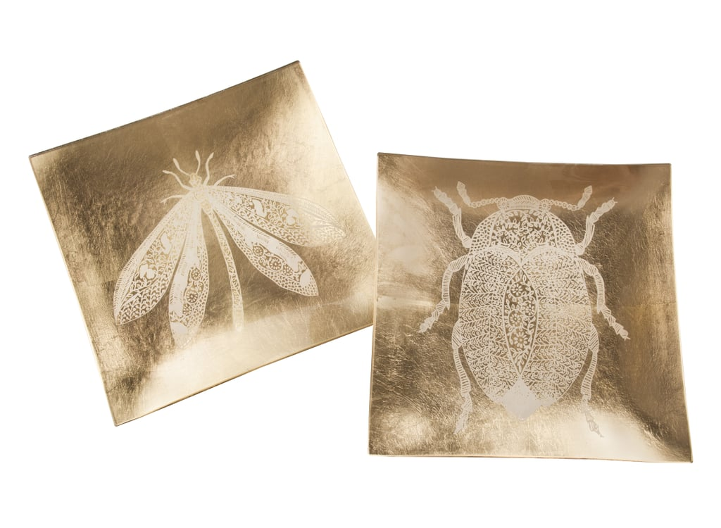Hang these decorative tiles ($20) on your wall or place them on your coffee table for a pop of gold.