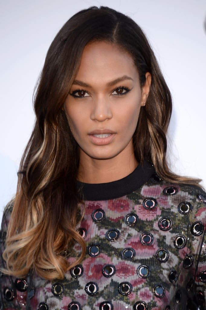 An extreme winged eyeliner look and barely there lipstick let Joan Smalls's ombré hair color take center stage.