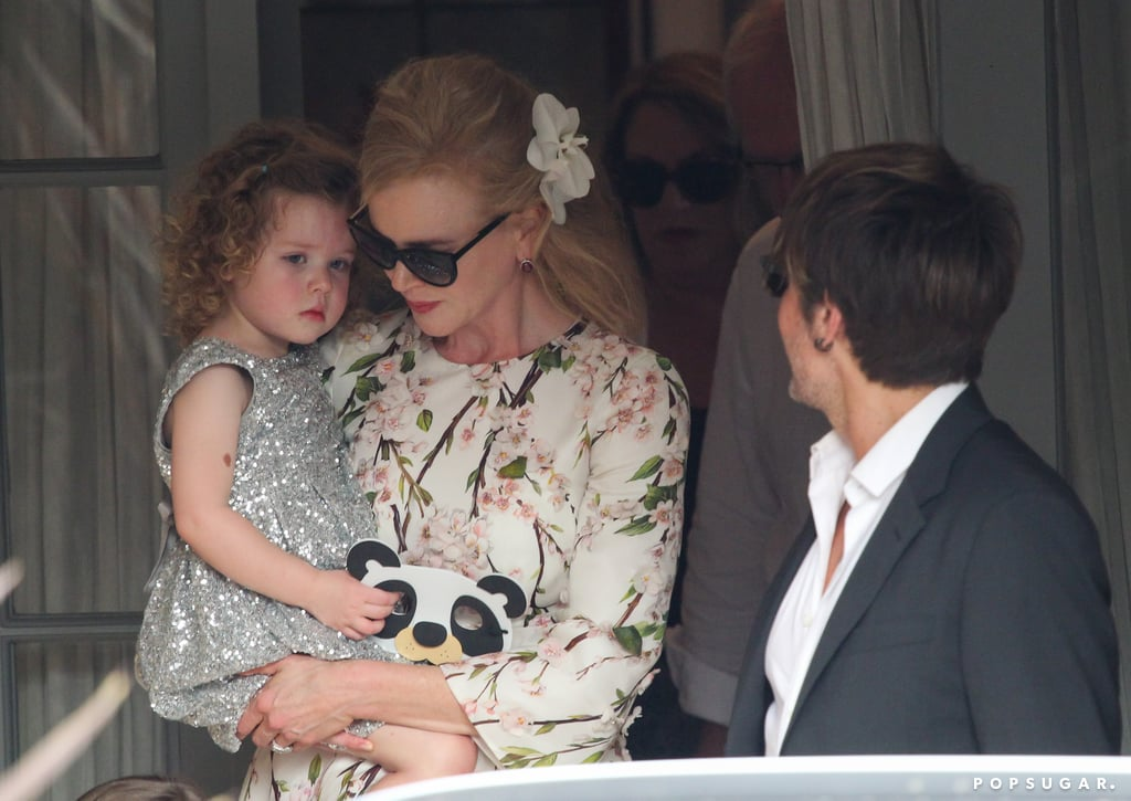 Nicole Kidman held her daughter, Faith, as Keith looked on.