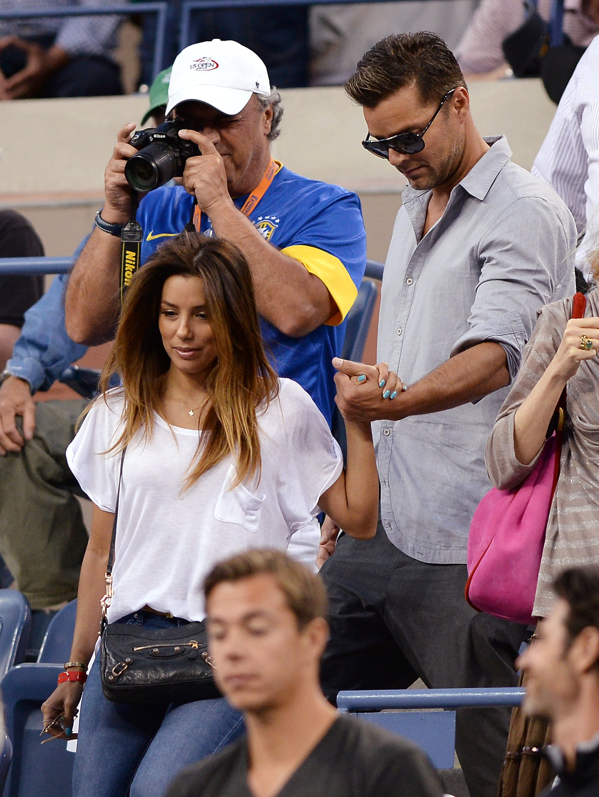 Eva Longoria stuck to basics in a white tee, dark denim, and a black crossbody bag at the US Open in NYC.