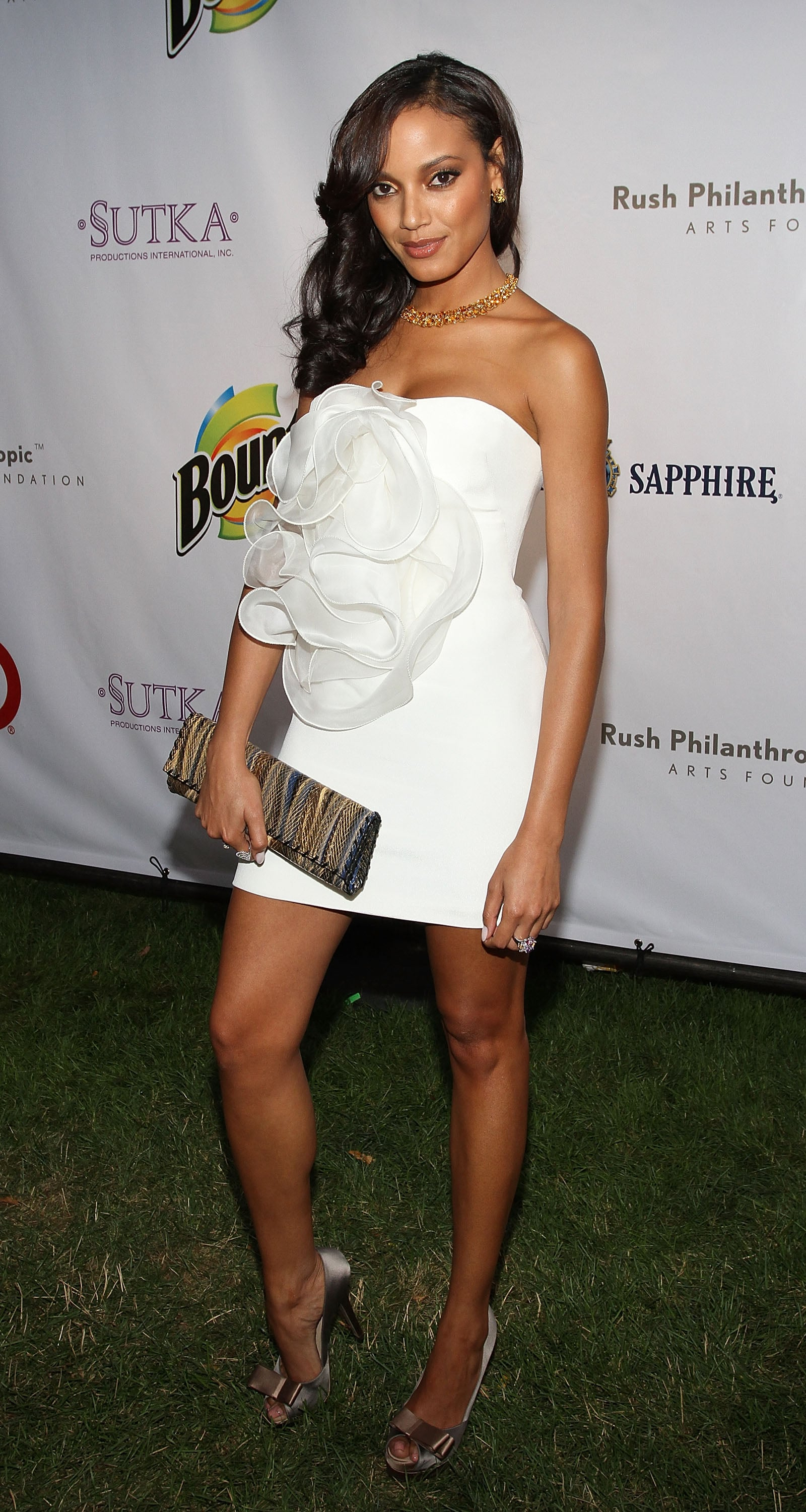 Selita works it in a LWD with a standout rosette detail at an event in the Hamptons.