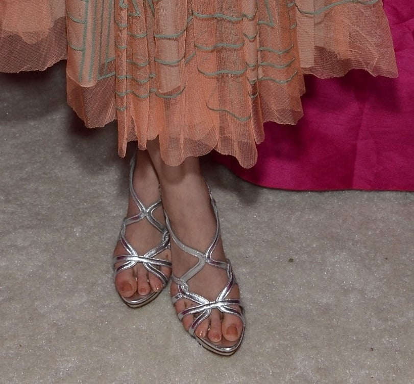Leven Rambin sported silver metallic sandals with her peach dress at Elton John's viewing party.
